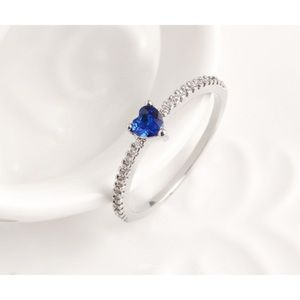 Sterling silver with blue heart shaped stone sz7